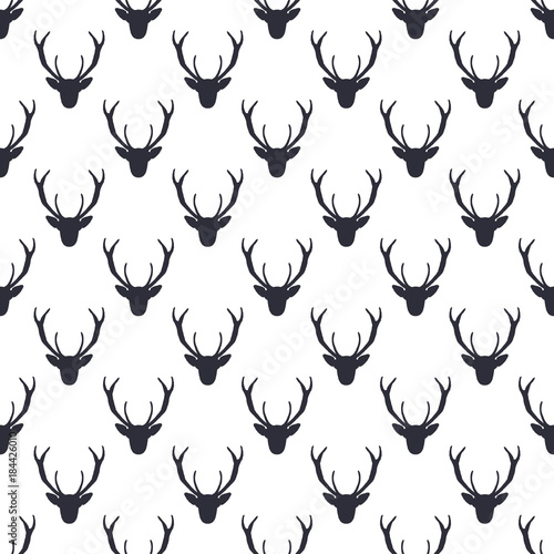 Deer head pattern. Wild animal symbols seamless background. Deers icon. Retro wallpaper. Stock vector illustration isolated on white. Monochrome design