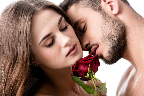 acctractive sensual couple with rose isolated on white Fototapete