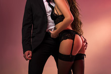 Cropped Image Of Successful Businessman With Beautiful Girl In Lingerie