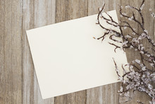 A Blank Greeting Card On Weathered Wood