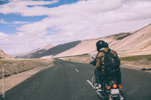 back view of two motorcyclists on mountain road in Indian Himalayas, Ladakh regi Wallpaper Mural
