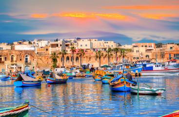 FototapetaMarsaxlokk village port of Malta, illuminate by sunset light, European travel in beautiful place