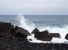 Waves Breaking Over Concrete C...