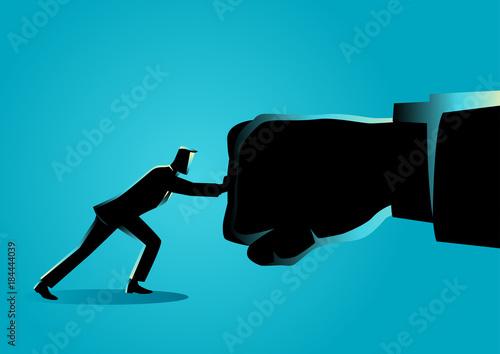 Cuadros en Lienzo Businessman holding a giant punch
