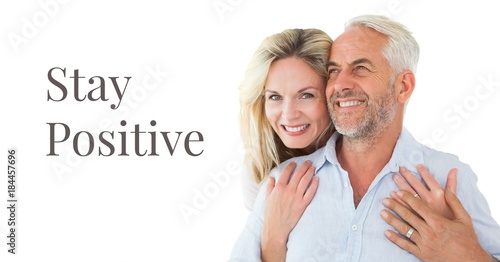 Photo  Stay positive text and happy older couple