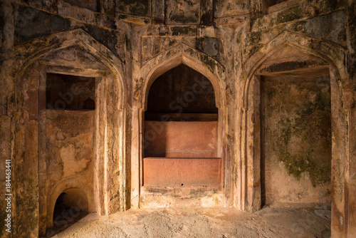 Foto op Plexiglas Rudnes Mandu India, afghan ruins of islam kingdom, palace interior, mosque monument and muslim tomb. Sunshine from door in dark corridor.