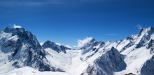 Panoramic View Of Snow Covered Mountain Peaks