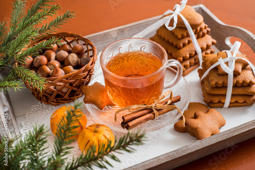 Aluminium Prints Buffet, Bar Traditional Christmas tea, gingerbread with a cup of hot tea, a large set of cookies on a tray on a wooden table