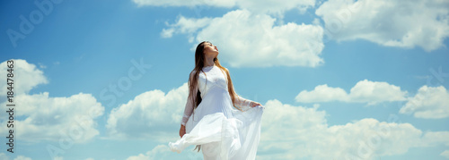 100327a04209 Girl enjoy sunny summer day on cloudy blue sky - Buy this stock ...