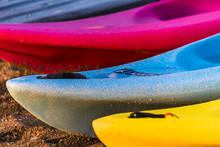 Colorful Kayaks Illuminated By...