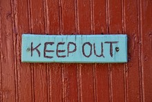Keep Out Warning Sign Over Old...