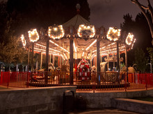 Fun Fair And Night . Colorful Chain Swing Carousel In Motion At Amusement Park