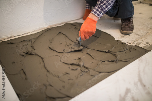Laying Ceramic Tiles Master Make Concrete Floor In Preparation For