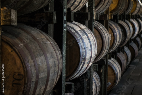 Leinwand Poster Bourbon Barrels in Rickhouse