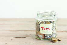 Coins In Jar With Tips Label