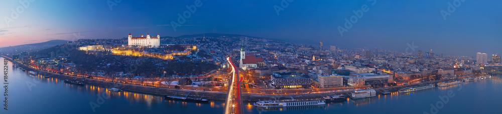 Fototapeta BRATISLAVA, SLOVAKIA, DECEMBER - 1, 2017:  Panoramic skyline of the City from SNP Bridge at dusk.