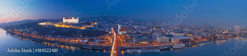 BRATISLAVA, SLOVAKIA, DECEMBER - 1, 2017:  Panoramic skyline of the City from SNP Bridge at dusk Wallpaper Mural