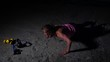 Sportswoman Doing Push Ups Exercise. Fitness Female Working Out on the Beach at Sunset. Athletic Young Woman is Engaged in Outdoor Sports. Static Shot.