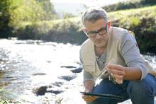 Biologist Testing Water Qualit...
