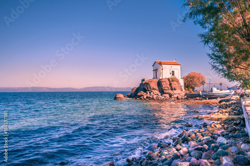 The little church of Panagia gorgona situated on a rock in Skala Sykamias, a pic Canvas Print