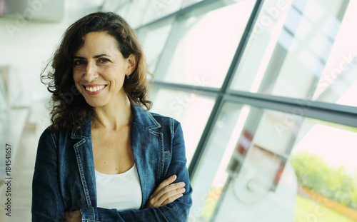 Indoor portrait of beautiful 40 years old woman Canvas Print