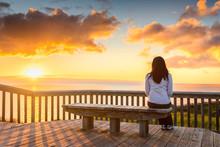 Woman Looking At Sunset At Hal...