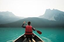 Rear View Of Man Kayaking In L...