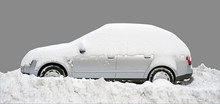 Silver Car Covered In Snow