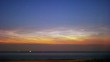 noctilucent clouds NLC over North Sea with ships passing summer midnight twilight timelapse