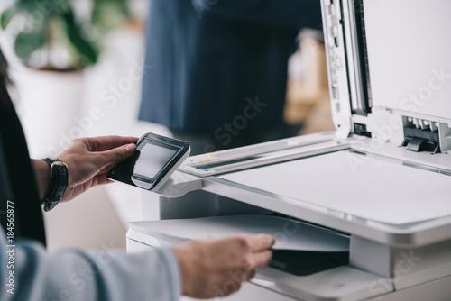 Canvastavla cropped shot of woman in formal wear using modern copier