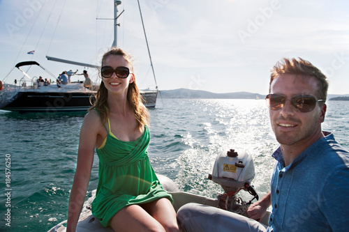 Photo Man and woman in yacht dinghy