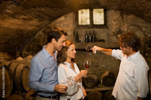 Obraz na plátne People tasting wine in cellar