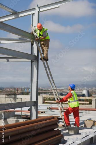 Worker standing on ladder Wallpaper Mural