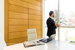Middle-aged businessman having coffe break in modern office