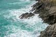 Sea waves crashing on the rock.