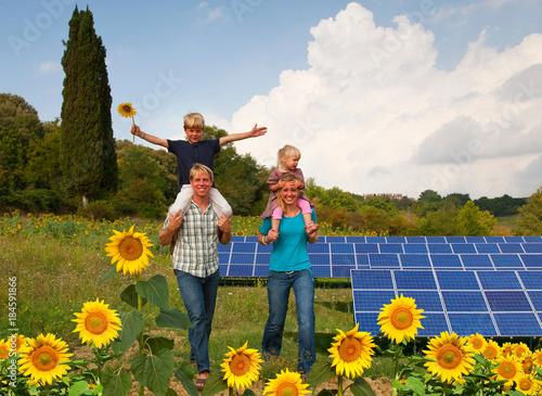 Fotografie, Obraz  Family in field by solar panels