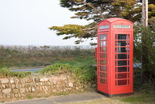 Red Telephone Box In Rural Set...