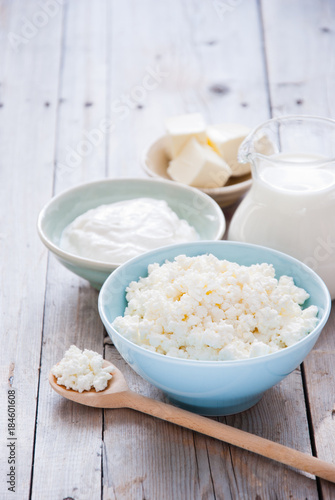 Poster Produit laitier Organic Farming Cottage cheese in a blue bowl, sour cream, butter and milk