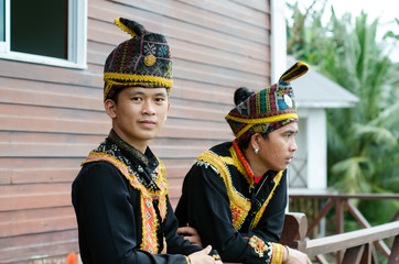 Young Men From Indigenous people of Sabah Borneo in East Malaysia in traditional attire during Musical and Dance Festival.