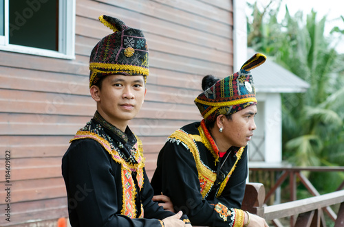 Valokuva  Young Men From Indigenous people of Sabah Borneo in East Malaysia in traditional attire during Musical and Dance Festival
