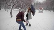 Man stealing a bag of the girl in the park. Robbery. Crime concept. Woman walking in a winter park, thief mugger following her then runs and robs her taking her bag. slow-motion