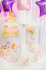 wooden carousel which serves as a base for mini cakes