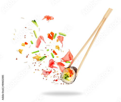 Poster Sushi bar Piece of sushi sandwiched between chopsticks, isolated on white background
