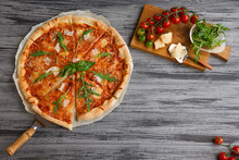Tasty Pizza With Cherries On Wooden Table