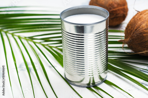 Opened tin can with coconut milk drink