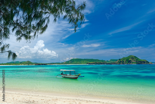 Photo Stands Tropical beach tropical beach in island Lombok, Indonesia with boat and turquoise lagoon.