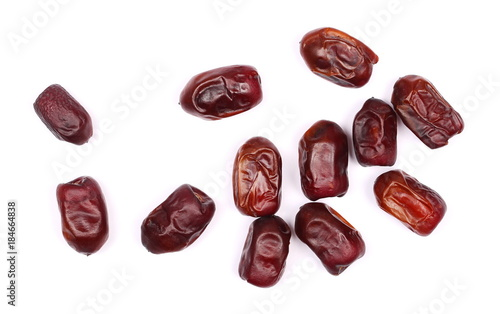 Fotografía  Dry dates isolated on white background, sweet fruit, top view