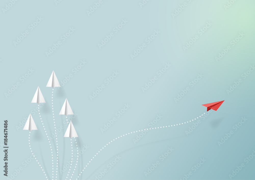 Fototapeta Paper airplanes flying on blue sky and cloud.Paper art style of business teamwork and one different vision creative concept idea.Vector illustration