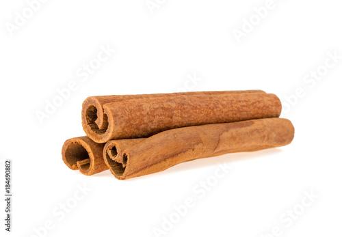 Fotografie, Obraz  three cinnamon sticks isolated on white background