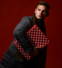 Stylish Guy With Gift On Red. Man In Vintage Style